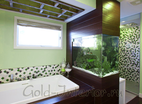 Здесь аквариум используется для зонирования пространства