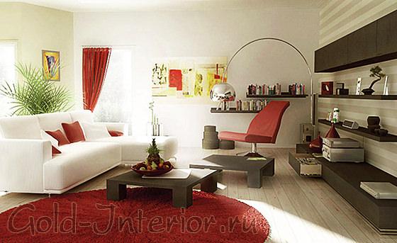Белый угловой диван и красный текстиль