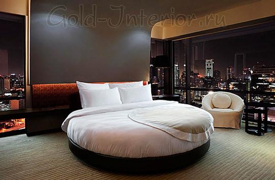 Чёрная круглая кровать в стиле минимализм