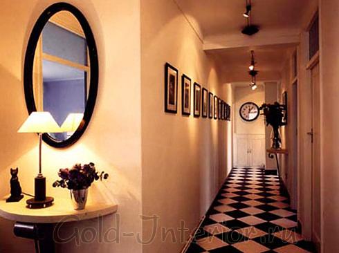 Чёрно-белая плитка и овальное зеркало