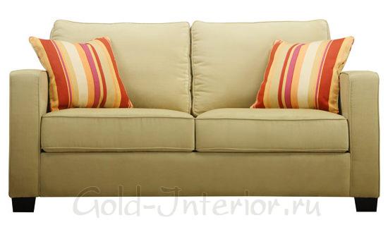 Диван цвета хаки с полосатыми подушками