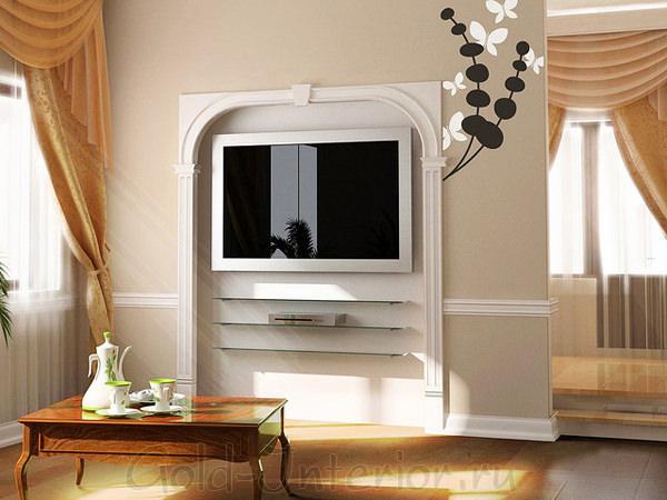 Интерьер однокомнатной квартиры с нишей - обрамление телевизора