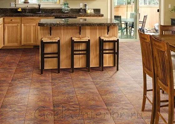 Ламинат в интерьере кухни имитирует каменную плитку