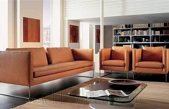 На фото терракотовый диван и кресла