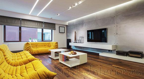 На фотографии представлен интерьер с тканевыми жёлтыми диванами