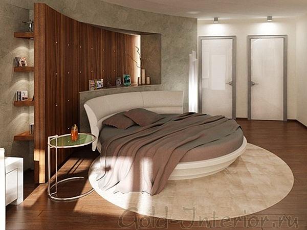 На фотографии круглая кровать