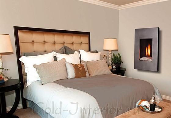 Настенный камин в интерьере спальни