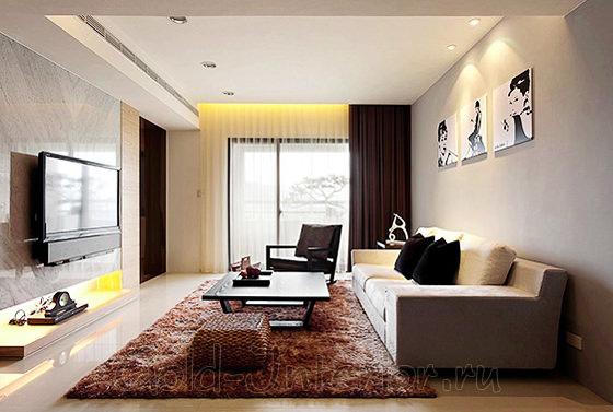 Освещение в гостиной - поворотные точечные светильники с лампочками накаливания