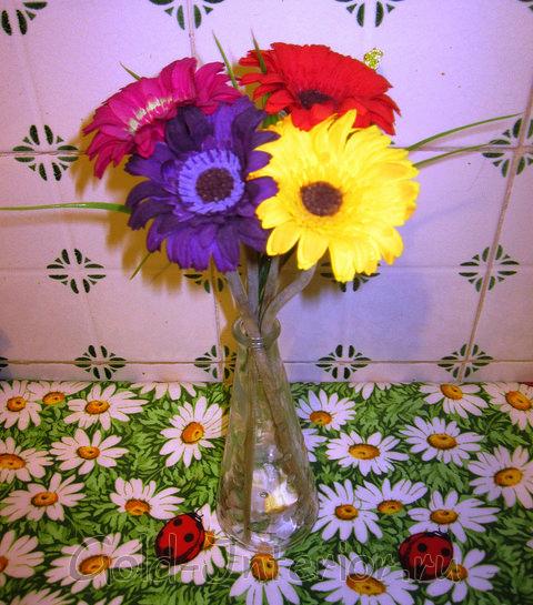 Радужный букет из одинаковых цветов