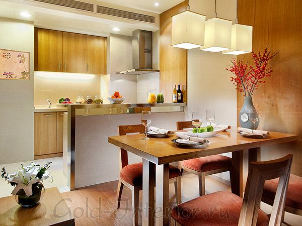 Современный интерьер кухни-студии с барной стойкой в восточном стиле