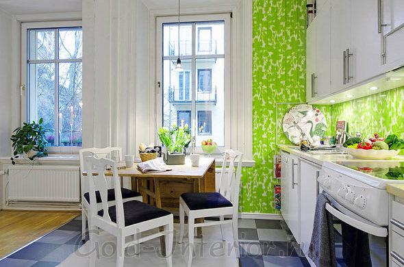 Столовая в интерьере объединённой кухни с гостиной