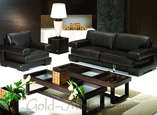 Восточный интерьер с чёрным диваном и креслом